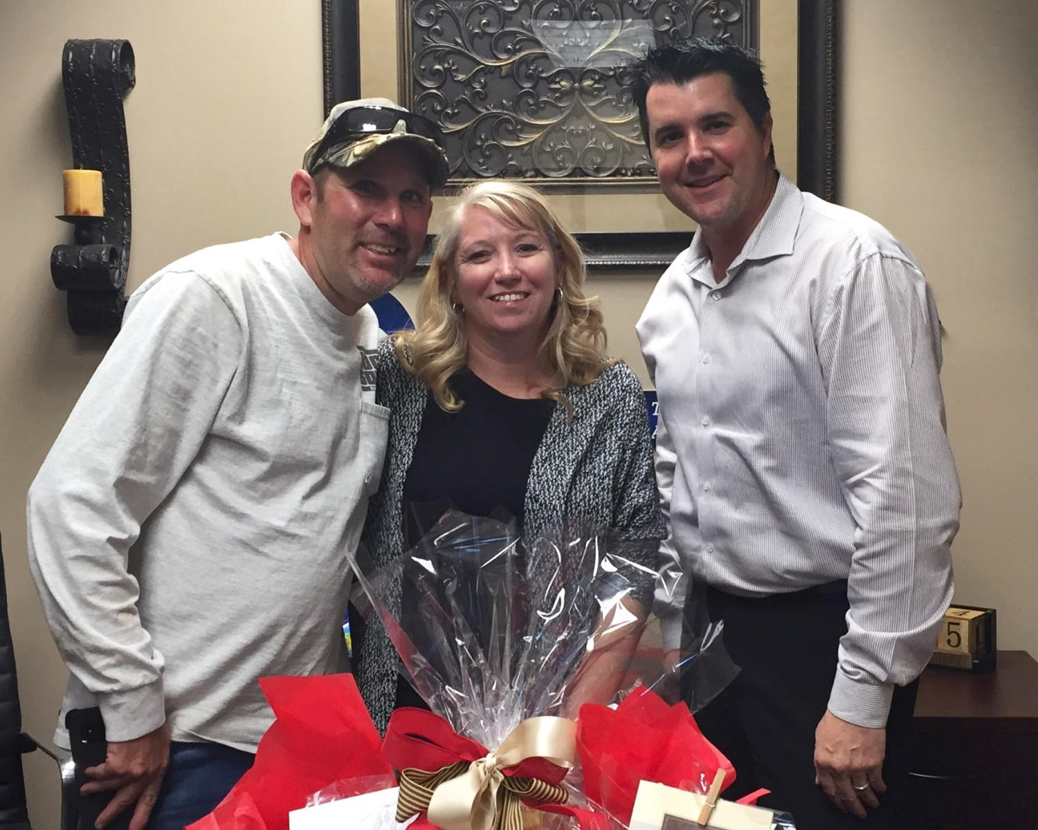 Matt and Stephanie Varney with Escrow Officer, Mark Woodworth